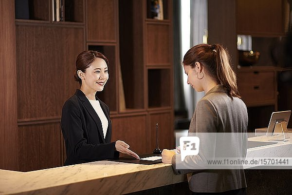 Young woman checking in at a hotel