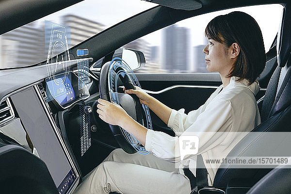 Japanese woman in self driving car