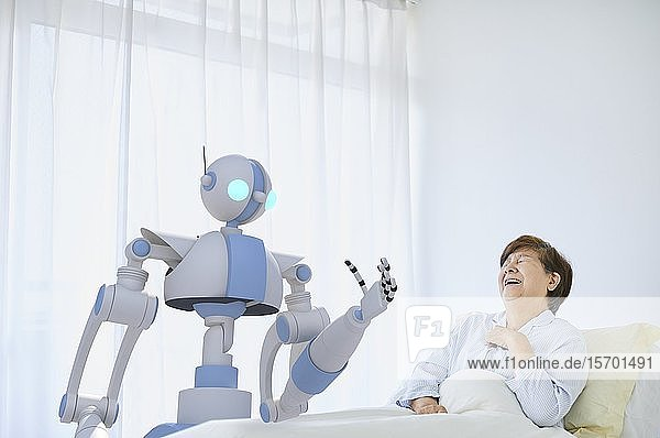 Senior Japanese woman with robot
