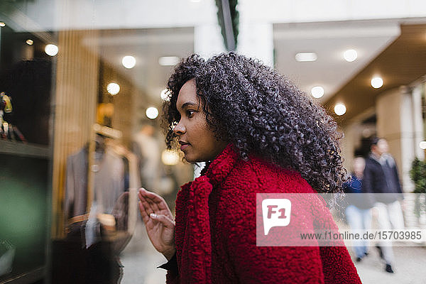 Young woman window shopping in mall