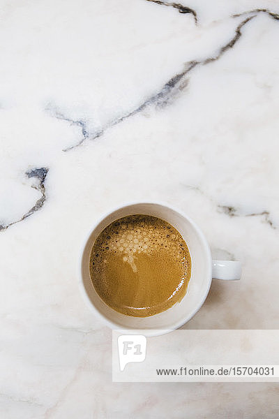 View from above espresso in mug on marble surface