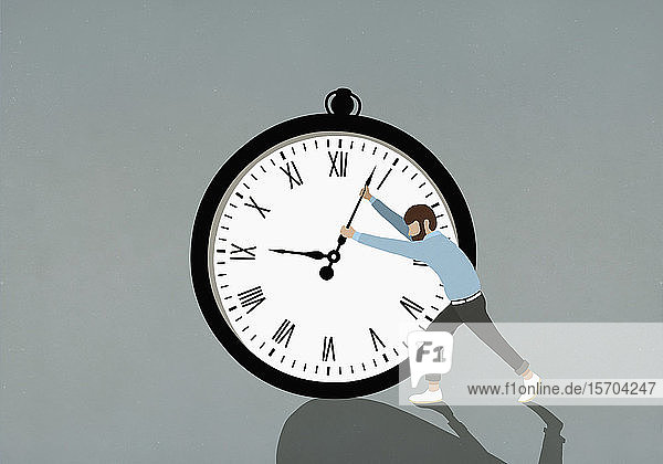 Man pushing hands of large stopwatch