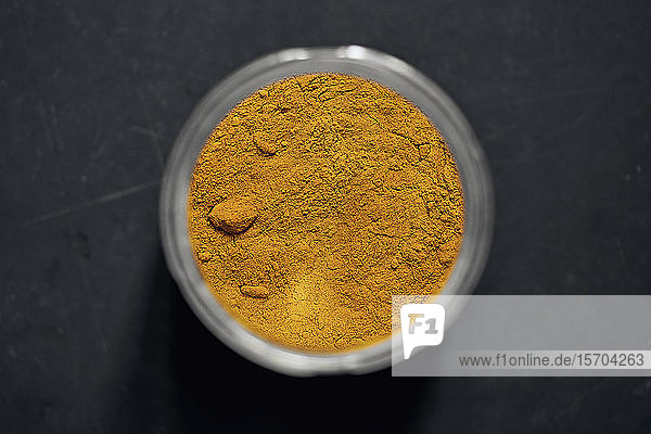 View from above turmeric powder in spice jar
