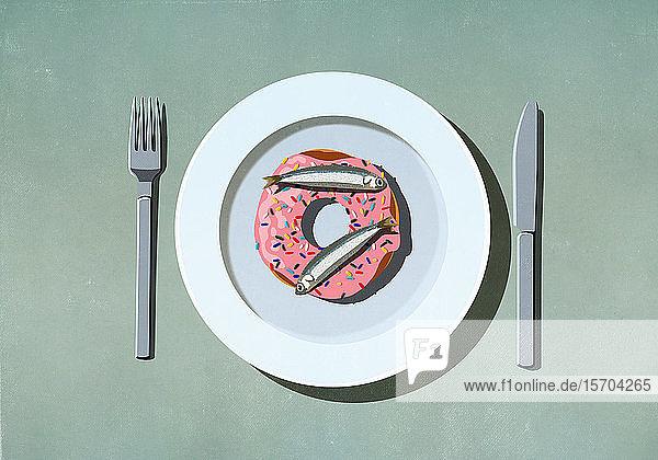 Sardinen oben auf dem Donut auf dem Teller