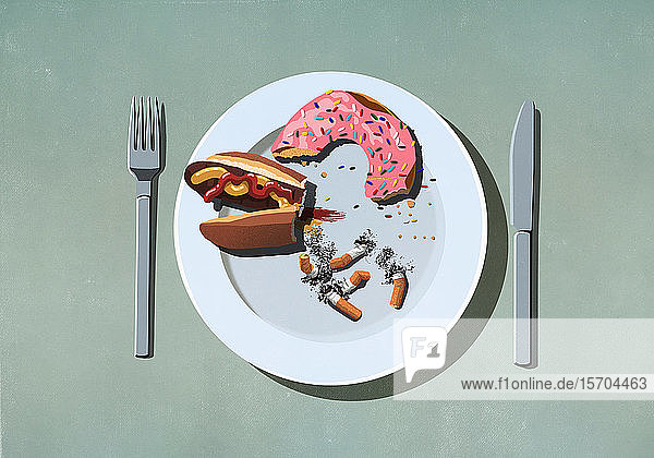 Half-eaten hot dog  donut and cigarette butts on plate