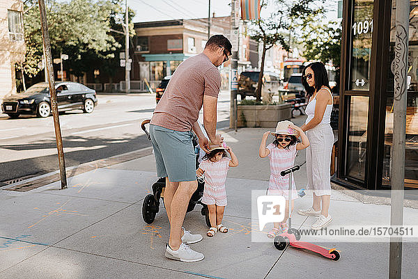 Family of four taking walk in city