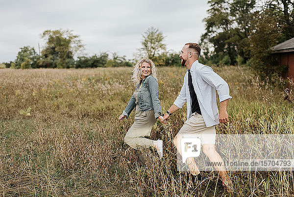 Young couple skipping in countryside