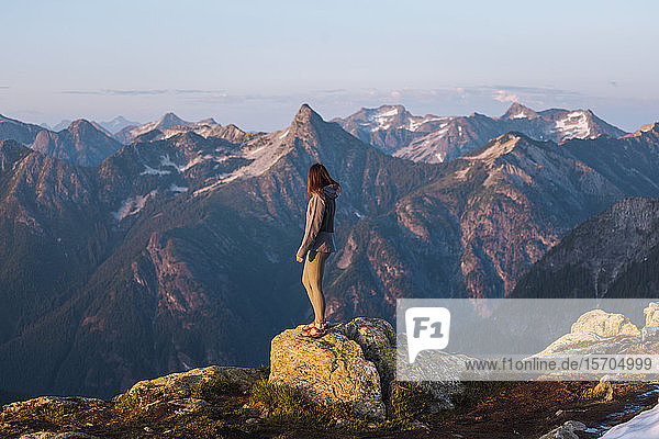 Female hiker enjoying view on peak  Winchester Mountain  North Cascades  Washington  USA