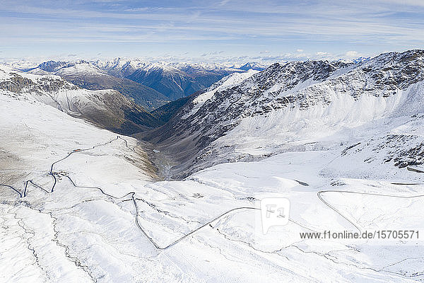 View by drone of mountain road in the snow  Giogo di Santa Maria (Umbrail Pass)  Stelvio Pass  Sondrio province  Valtellina  Lombardy  Italy  Europe
