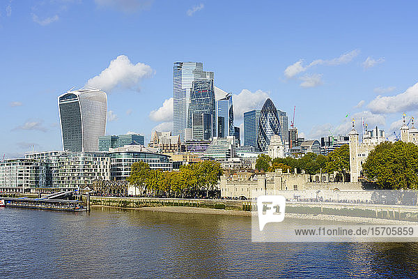 City of London skyscrapers and the Tower of London viewed across the River Thames  London  England  United Kingdom  Europe