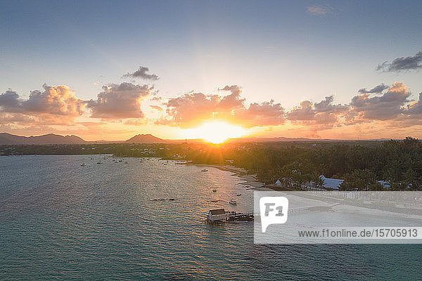 African sunset over tropical lagoon and pier  aerial view  Trou d'Eau Douce  Flacq district  East coast  Mauritius  Indian Ocean  Africa