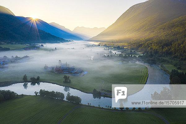 Mist over the cultivated fields along Stryneelva river  aerial view  Stryn  Nordfjorden  Sogn og Fjordane county  Norway  Scandinavia  Europe