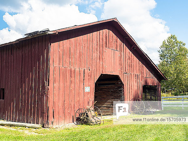 Red barn and old farm equipment  Valle Crucis  North Carolina  United States of America  North America