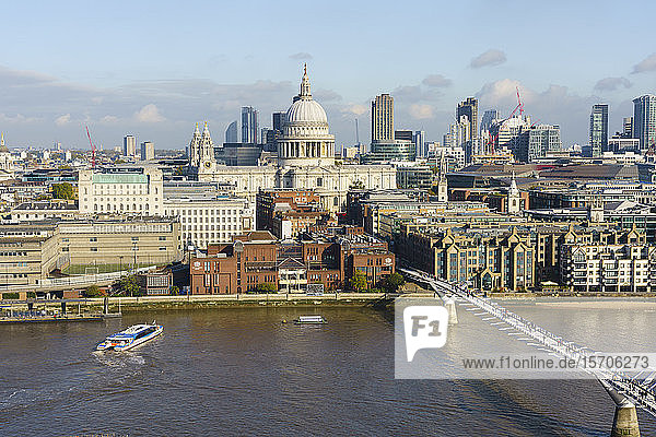 High view of St. Paul's Cathedral and City of London skyline with River Thames and Millennium Bridge in foreground  London  England  United Kingdom  Europe