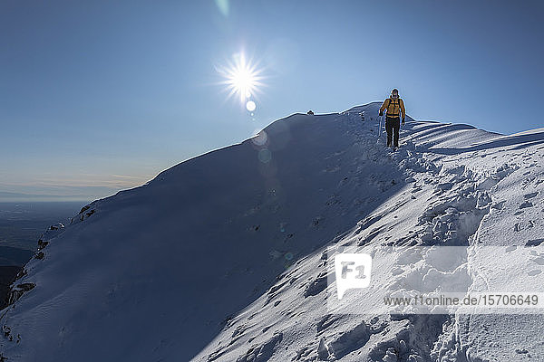 Mountaineer hiking on snowy mountain  Lecco  Italy