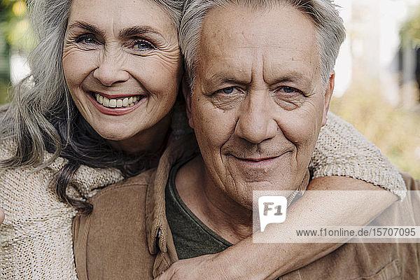 Portrait of a happy senior couple outdoors
