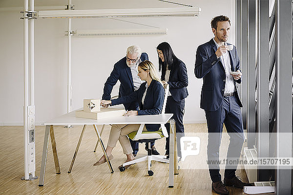 Businessman having a coffee break during a meeting in office