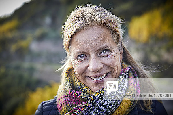 Portrait of a smiling mature woman outdoors