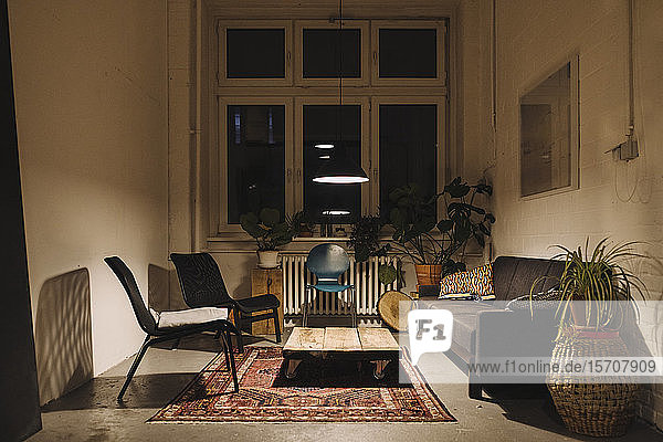 Lounge room in an office at night
