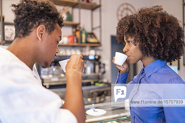 Couple drinking coffee in a cafe