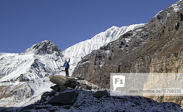 Mountaineer on top of a rock  Dhaulagiri Circuit Trek  Himalaya  Nepal