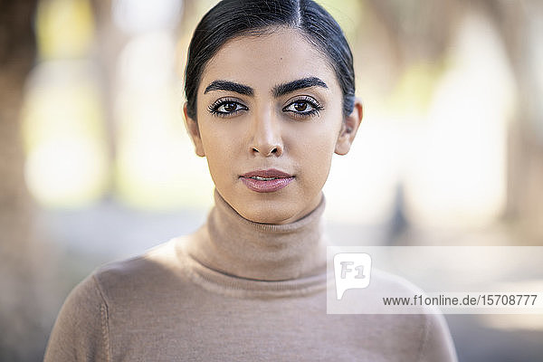 Portait of a beautiful young woman outdoors