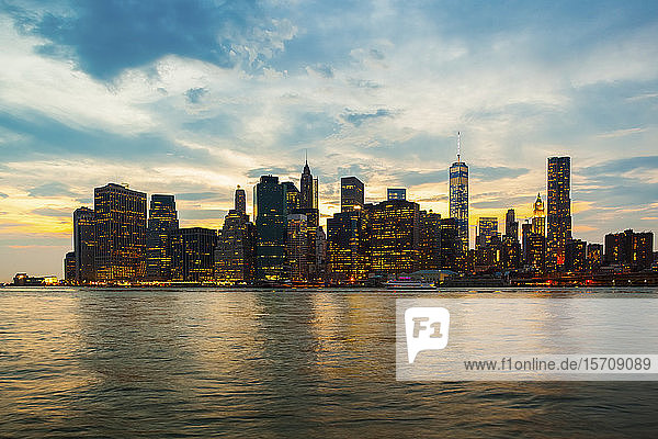 USA  New York  New York City  Manhattan skyline illuminated at dusk