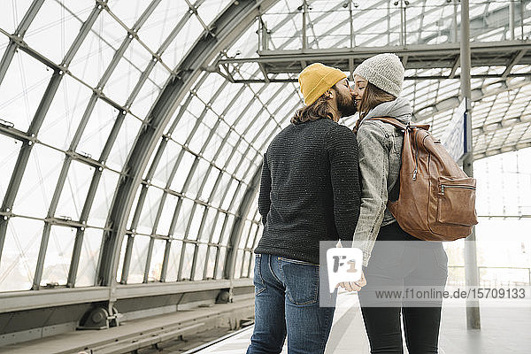 Young couple kissing at the station platform,  Berlin,  Germany