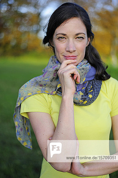 Portrait of woman in the nature  wearing green t-shirt and scarf