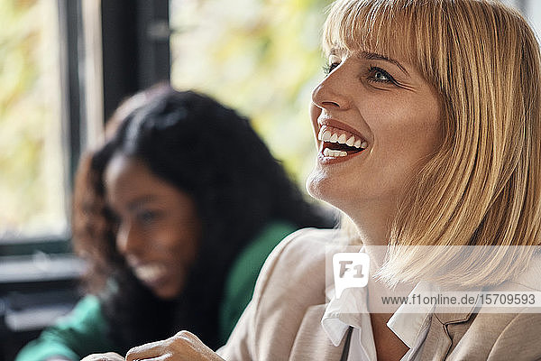 Portrait of laughing businesswoman in office