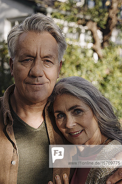 Portrait of senior couple in garden of their home