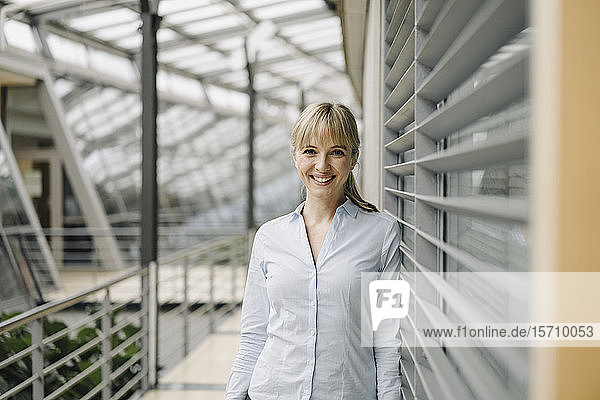Portrait of a smiling young businesswoman in a modern office building