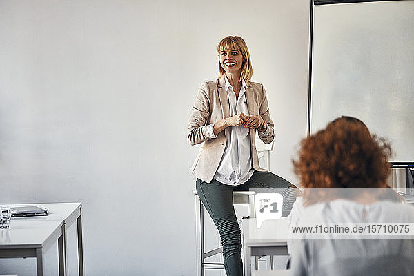 Pregnant woman leading a workshop in office
