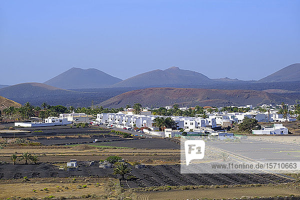 Spain  Canary Islands  Lanzarote  La Geria region  Yaiza  Village in landscape
