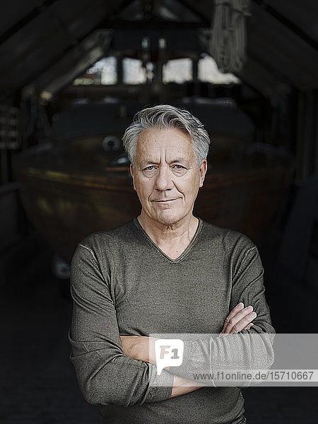Portrait of a senior man in a boathouse