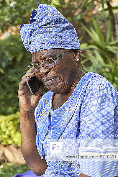 Senior woman on the phone outdoors