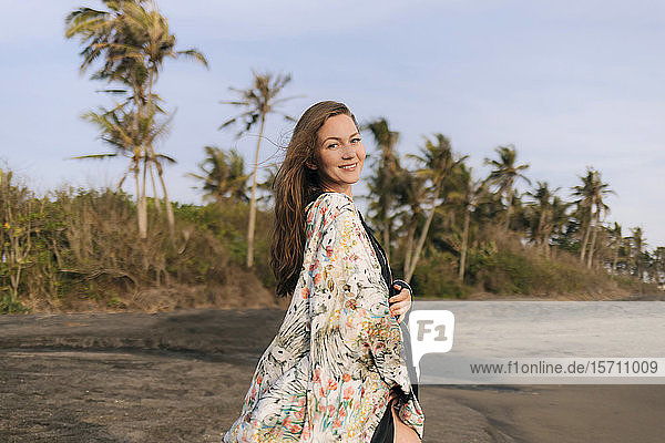 Young woman at the beach  Kedungu beach  Bali  Indonesia