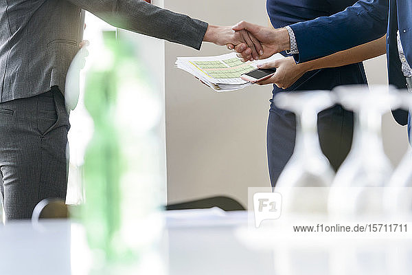 Close-upof business people shaking hands in office
