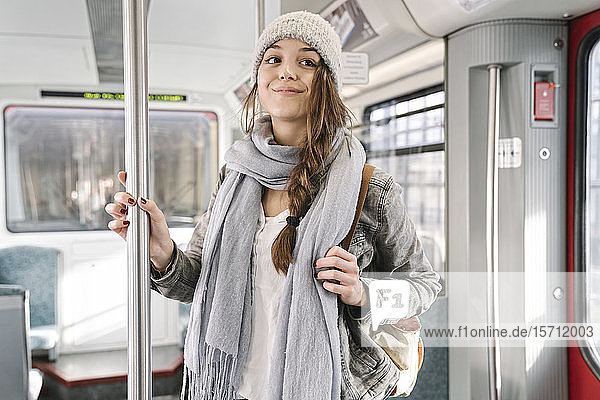 Portrait of young woman in a metro