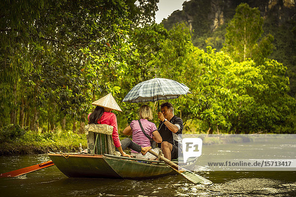 Tourists in rowing boat  Ngo Dong River  Ninh Binh Provice  Vietnam  Asia