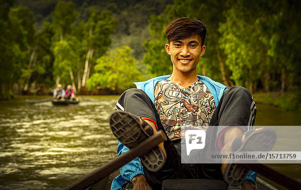 Man in rowing boat  Ngo Dong River  Ninh Binh Province  Ha Long Bay  Vietnam  Asia