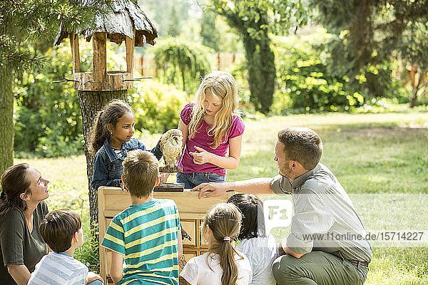 School children learning about bird species