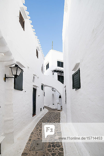 Spain  Menorca  Binibeca  Whitewashed houses and narrow alley