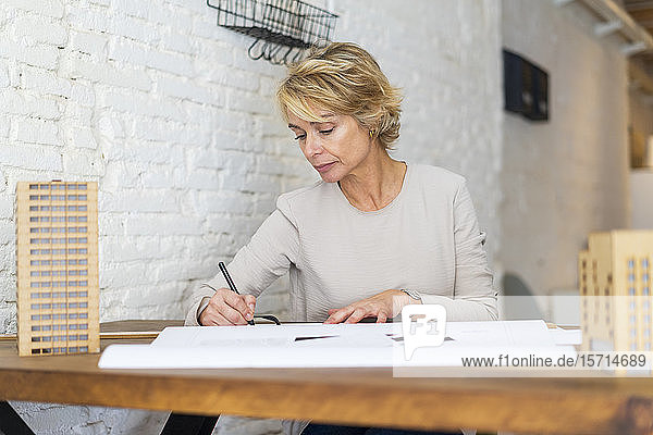 Portrait of architect working at desk in a studio