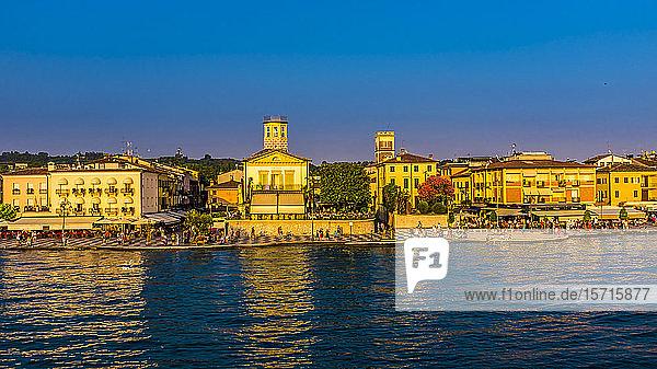 Italy  Province of Verona  Lazise  Promenade of lakeshore city at dusk