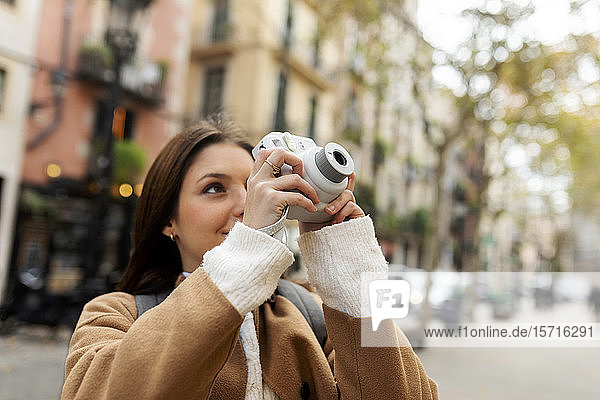 Young woman taking pictures in the city  Barcelona  Spain
