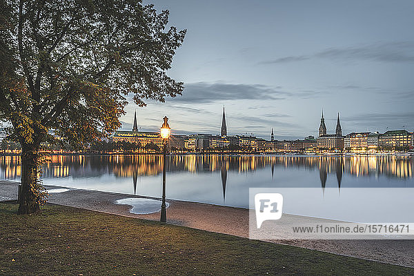 Germany  Hamburg  Waterfront buildings reflecting in Inner Alster Lake at dawn