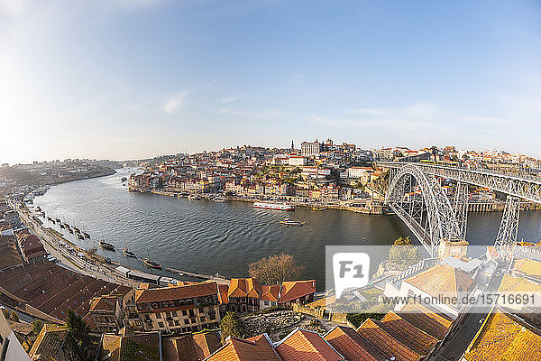 Portugal  Porto District  Porto  Sky over city buildings surrounding Douro river and Dom Luis I Bridge