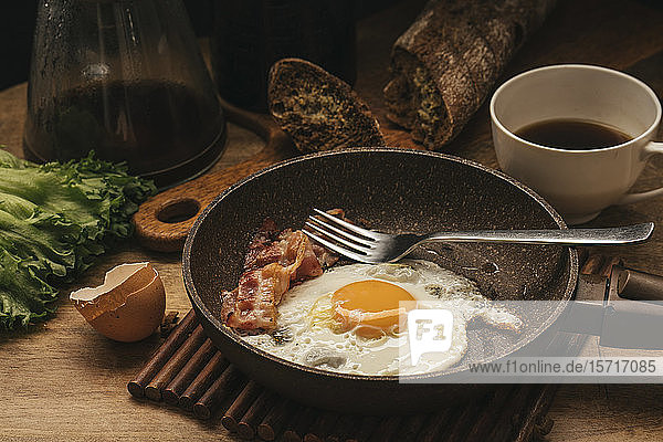 Russia  Saint Petersburg  Fried egg and bacon on frying pan