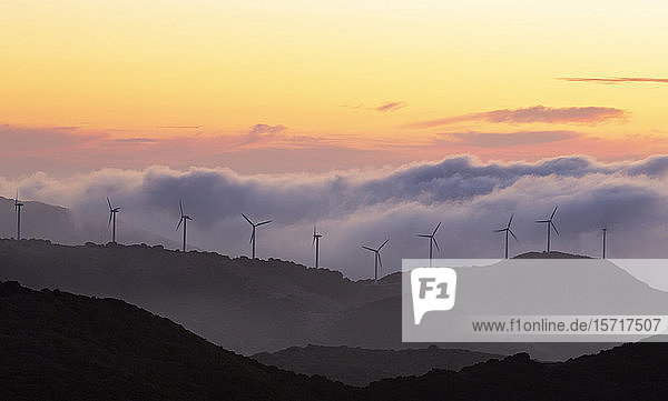Gibraltar  Wind turbines in landscape at sunset